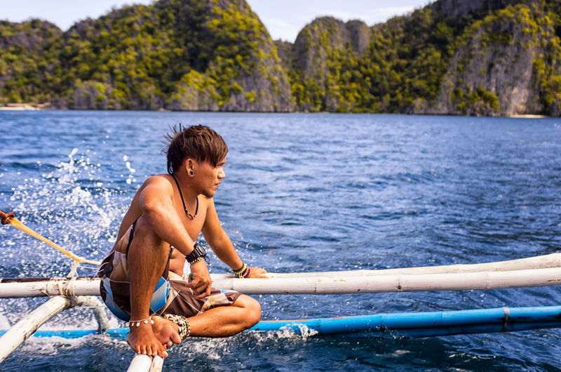One Man Only Water People Shirtless Sitting Sea Nature Landscape Pentax EyeEmNewHere Nature_collection Island Philippines Coron, Palawan Tranquility Tropical Climate Palm Tree Nature Transportation Boat Outdoors Nautical Vessel
