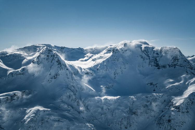 Majestic mountain range in the austrian alps in sportgastein in deep winter conditions.