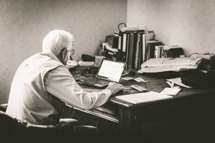 The Old Man and the PC Aged Envision The Future Grey Hair Indoors  Laptop Learning Man Old Sitting Table Working
