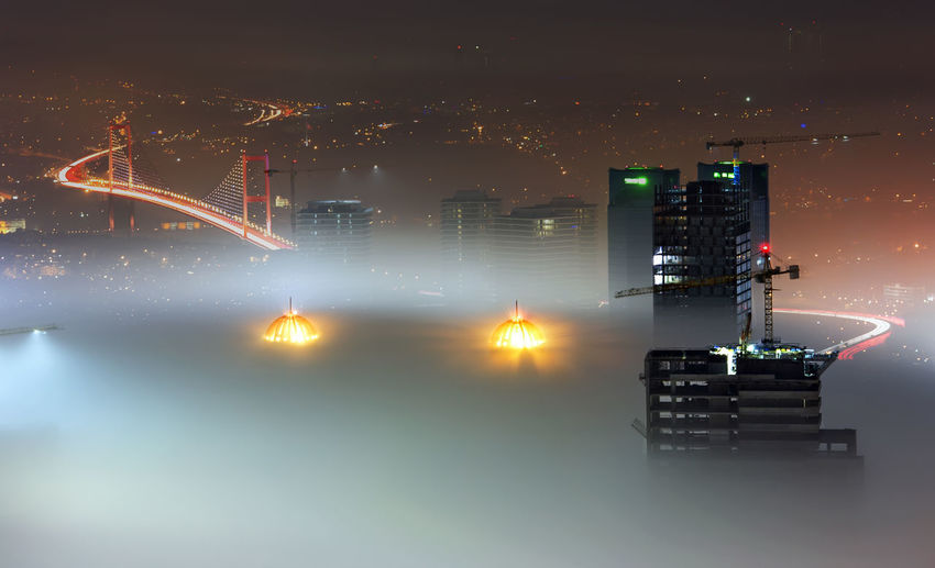 High angle view of incomplete skyscrapers in foggy weather with bosphorus bridge
