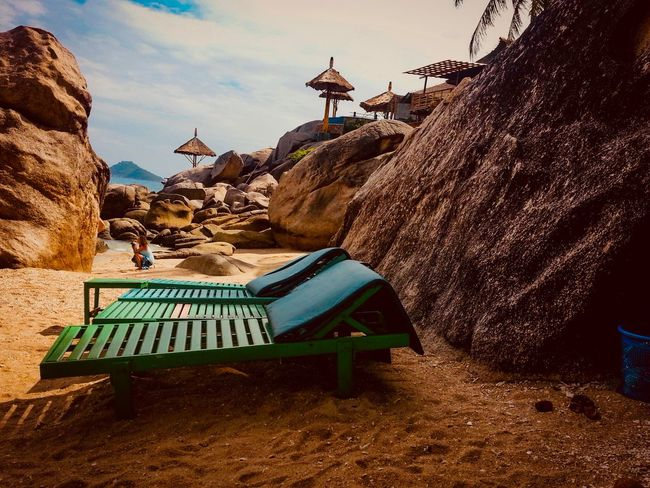 Beach at Koh Tao Thailand Island Rock Sunbathing Koh Samui Beauty In Nature Koh Tao,Tao Island,Southern Thailand Holiday Backgrounds People Beach Architecture Built Structure Nature Sky Building Exterior Day Religion Cloud - Sky Outdoors Travel Destinations Sunlight Seat Travel