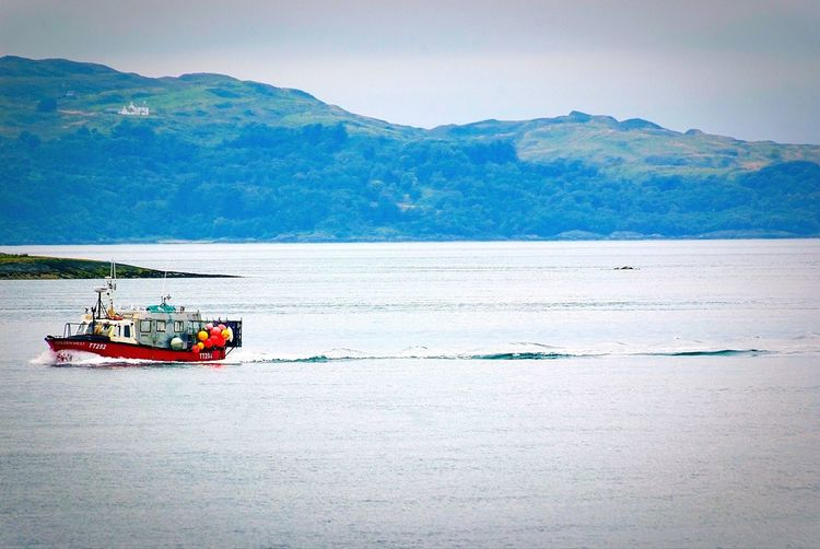 Ferry and fishing boats Mountain Beauty In Nature Sky Nature Outdoors Scenics Day Sea Water Nautical Vessel No People West coast of Scotland