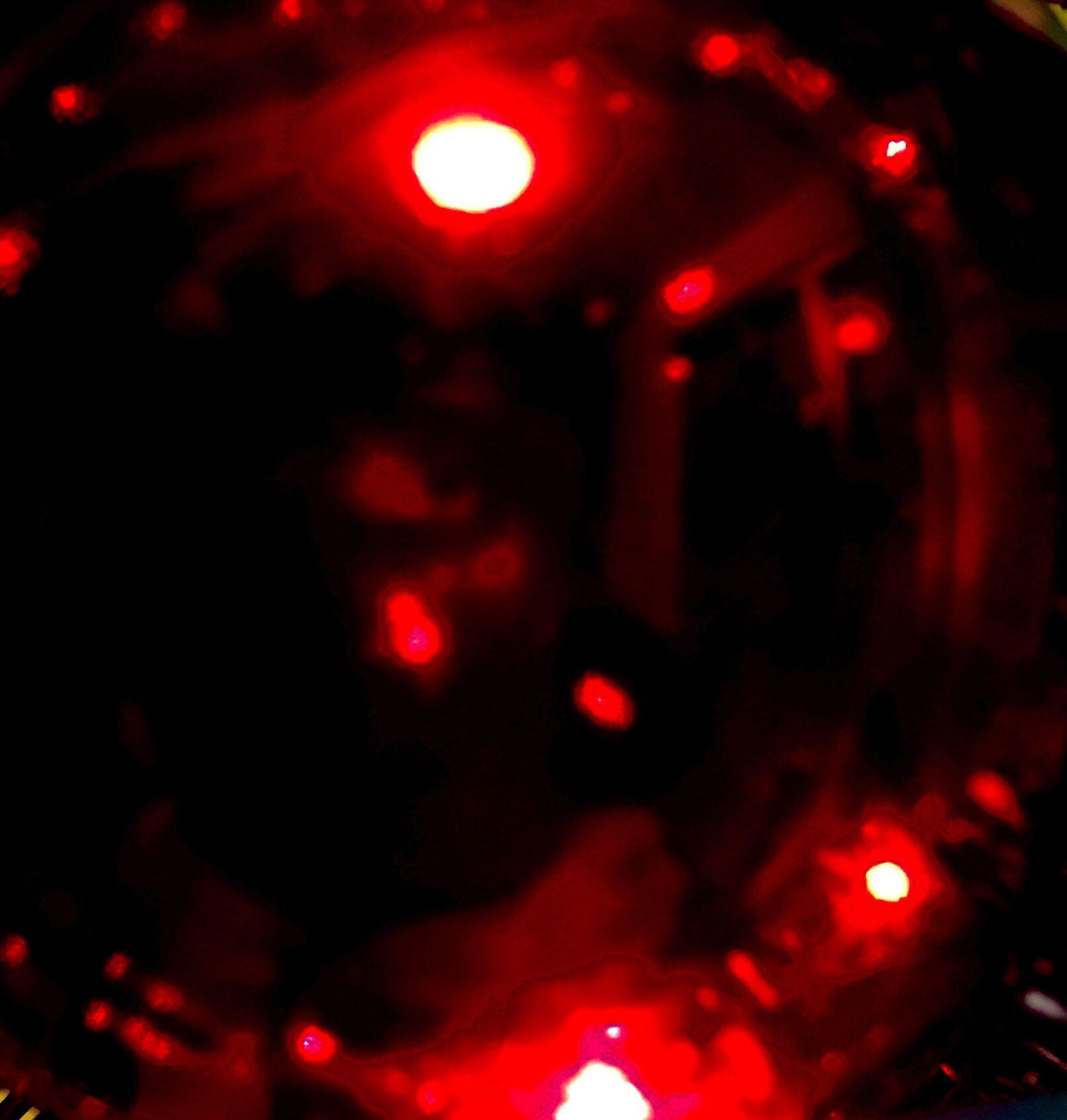 illuminated, red, night, lighting equipment, defocused, indoors, glowing, lens flare, light - natural phenomenon, close-up, no people, celebration, dark, focus on foreground, car, decoration, selective focus, multi colored, transportation