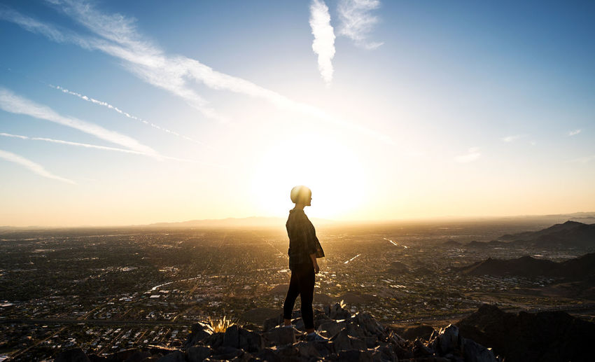 Sky One Person Sunlight Standing Mountain Nature Cityscape Landscape Full Length City Beauty In Nature Building Exterior Side View Cloud - Sky Sunbeam Sun Environment Solitude Leisure Activity Outdoors Looking At View Lens Flare