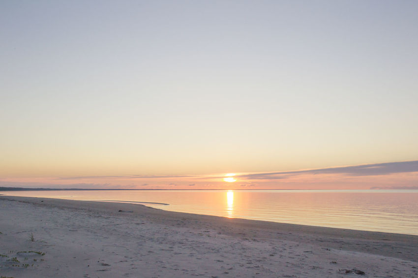 Baltic Sea Beach Beauty In Nature Blue Calm Horizon Over Water Idyllic Lativia Nature No People Non-urban Scene Orange Orange Color Outdoors Pink Remote Scenics Sea Shoreline Sky Sun Sunset Tranquil Scene Tranquility Water