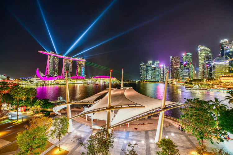 Laser show of Marina bay sands Singapore city skyline this is travel landmark Architecture Built Structure Night Building Exterior Illuminated City Building No People Lighting Equipment Skyscraper Office Building Exterior Sky High Angle View Travel Destinations Plant Outdoors Cityscape Modern Nightlife Lasershow Landscape Singapore Landmark Marina Bay Sands