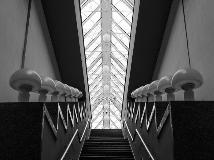 city Architecture Built Structure Symmetry Footbridge Covered Bridge Arch Bridge Bridge Architectural Design Ceiling Railing Stairway Reflecting Pool Hanging Light Steps And Staircases Hanging Spiral Staircase Geometry Bridge - Man Made Structure Elevated Walkway