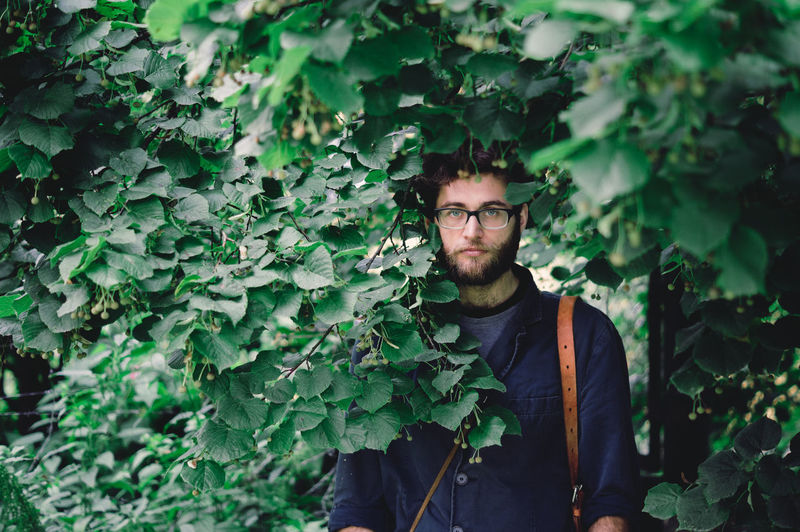 Portrait of a friend Glasses Green Beard Leaves Looking At Camera Naturelovers One Person One Young Man Only Outdoors Portrait Of A Friend Standing Tree Young Adult First Eyeem Photo
