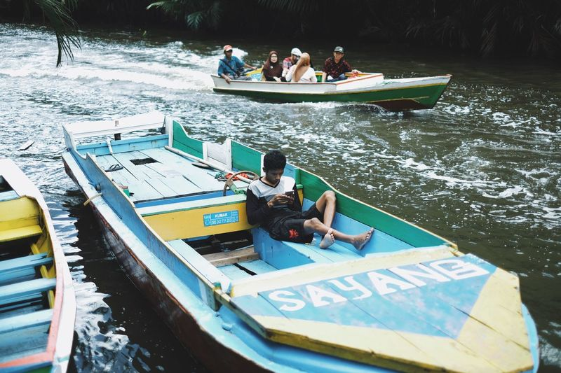 Sayang mean love.... Water Nautical Vessel Transportation Real People Men Day Mode Of Transportation Group Of People People Nature Leisure Activity River Lifestyles