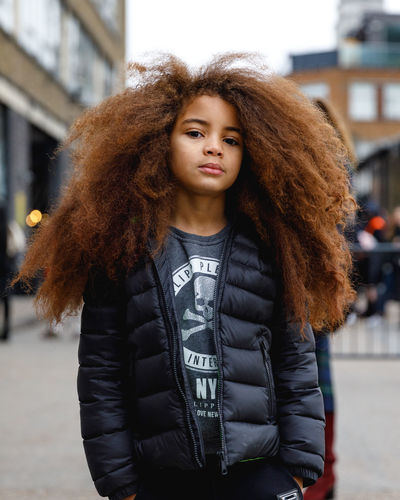 London Fashion Week Mens 2019 Redefining Menswear One Person Lifestyles Real People Standing Portrait Clothing Curly Hair Jacket Front View Hairstyle Focus On Foreground Leisure Activity City Looking At Camera Warm Clothing Architecture Hair Winter Outdoors Leather Fashion London Young Adult Fashion Photography