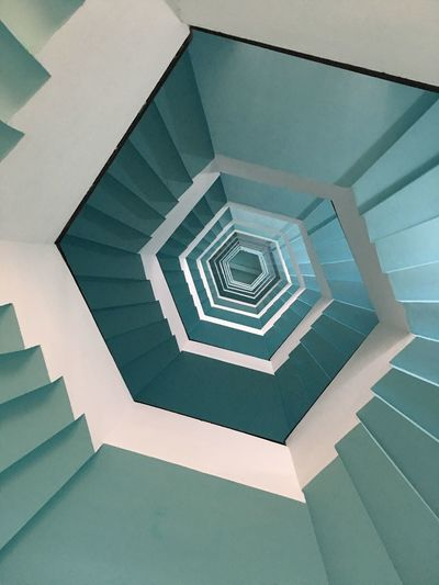 Spiral staircase Staircase Architecture Pattern Steps And Staircases Indoors  Spiral Built Structure Spiral Staircase No People Geometric Shape Low Angle View Building Feature Shape Railing Directly Below Design