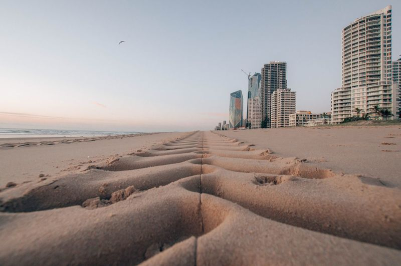 Sky Beach Land Sea Water Sand Built Structure Nature Architecture Building Exterior Clear Sky City Building Day No People Scenics - Nature Travel Destinations Outdoors Travel Office Building Exterior