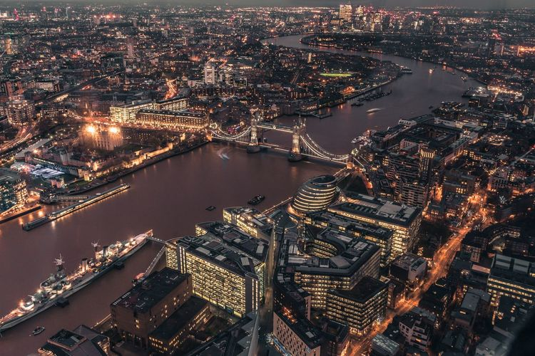High Angle View Of Illuminated Tower Bridge Over Thames River
