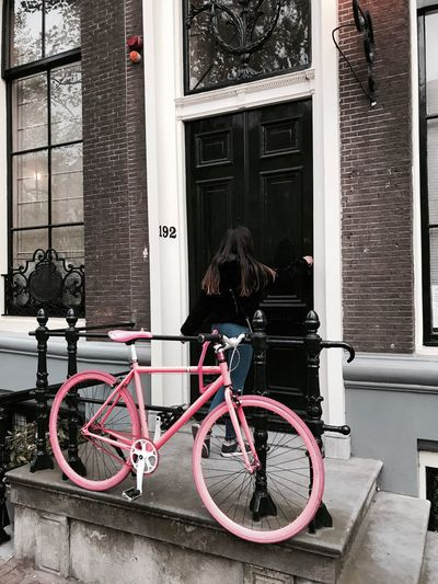 Bicycle parked by window