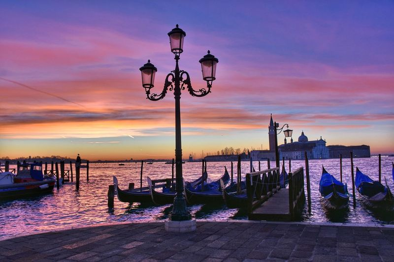 Sunset Sea Beach Pier Sky Outdoors Horizon Over Water Street Light Water Travel Destinations Nautical Vessel No People Vacations Harbor Cityscape Multi Colored Building Exterior City Urban Skyline Gondola - Traditional Boat Adventures In The City