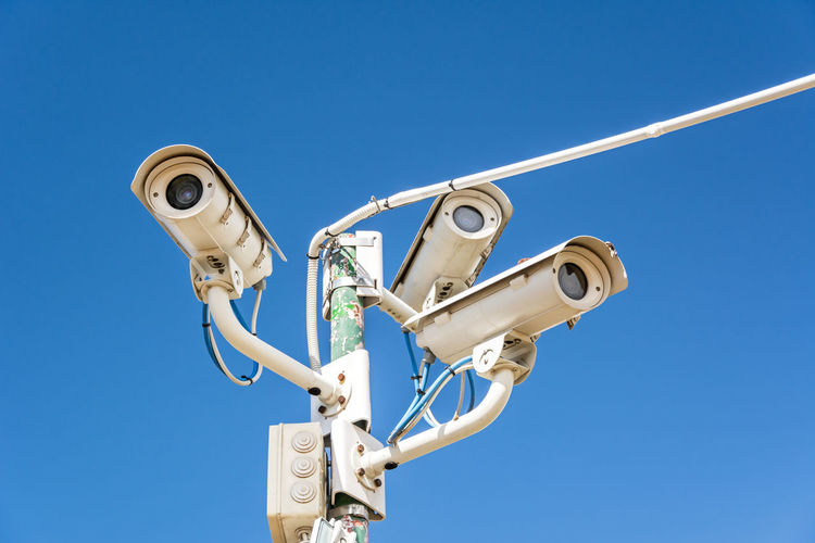 Surveillance cameras in front of blue sky Surveillance Video Surveillance Camera Camera Surveillance Security Border Border Security Internal Security Surveillance System Cctv Freedom Private Privacy Privacy Spying Data Security RISK Surveillance State Spy Data Terror Terrorism Crime Fight Against Crime Record Control Constant Surveillance Restricted Area Education Video Total Surveillance Monitor Security Alarm Protection Sky Copy Space Border Control  Immigration Migration Surveillance Camera Border Border Guard Security Border Control  Control Film Security Big Brother