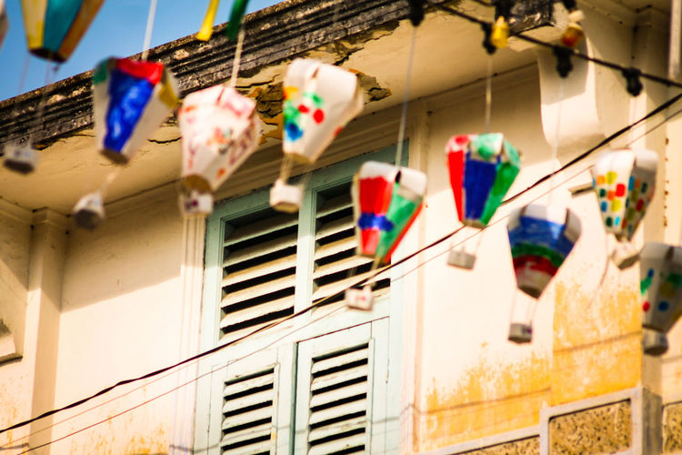 Paper Lanterns Multi Colored Hanging Built Structure Low Angle View No People Architecture Building Exterior Day Outdoors Close-up City Streets Of Penang Penang Malaysia The Week On EyeEm Urban Detail Celebration Whimsical