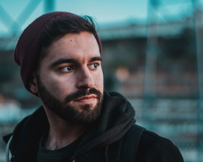 Looking for a little light Porto Portugal Bridge Nikon Bokeh EyeEm Selects Portrait Men Macho Beard Headshot Winter Handsome City Individuality Alternative Lifestyle Thoughtful Caucasian Day Dreaming Hooded Shirt Pretty Suave Thinking Hood - Clothing Introspection Hood