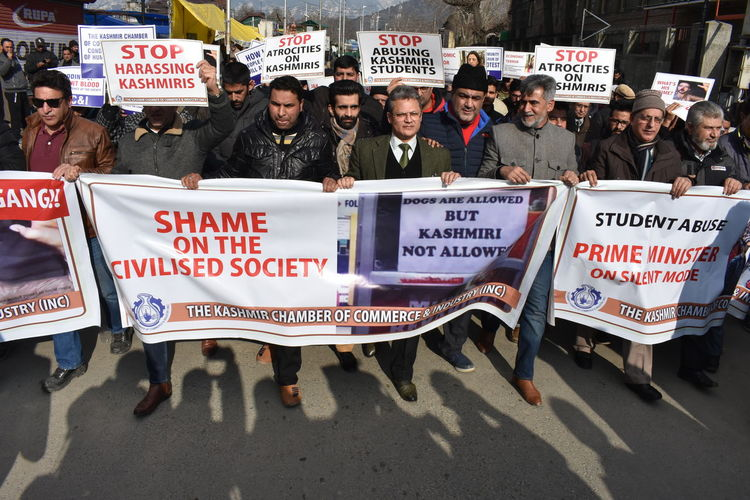 Traders carried out a protest in Srinagar on Friday against the harrassment of Kashmiris in different parts of India. Kashmir Demonstration Politics And Government Politics Democracy Placard Conflict Protest