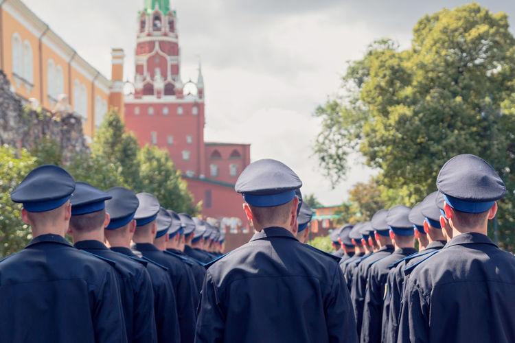 Rear view of people in uniform