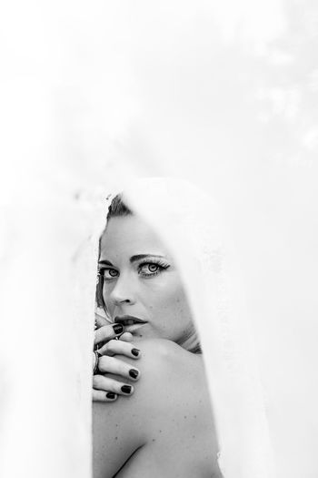 Portrait of woman seen through fabric
