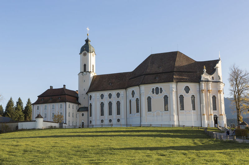 Architecture Building Exterior Built Structure Building Grass Religion Belief Sky Place Of Worship Spirituality Nature Plant Land No People History Day Clear Sky Outdoors Wieskirche