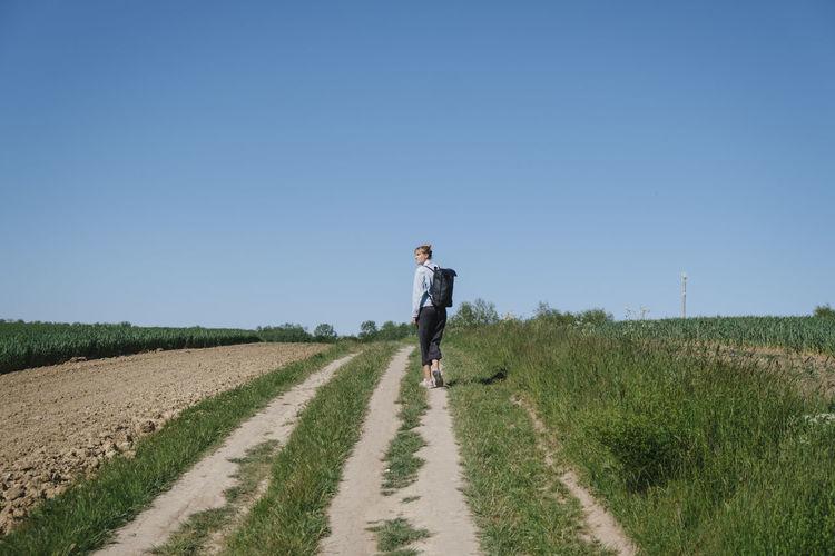 Full length of man on field against clear sky