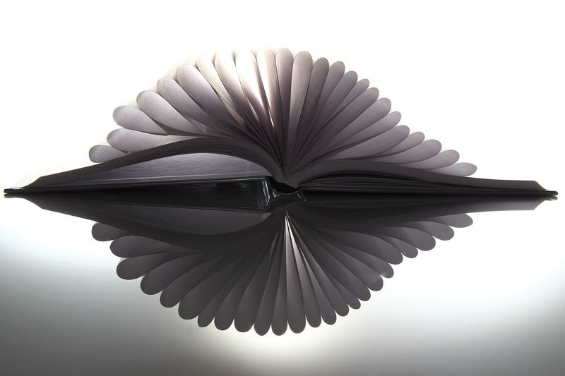 Paper/Book/Reflection ;o) Abstract Photography Books EyeEm Gallery Reflection Abstract Abstract Art Art And Craft Close Up Creativity Design Details Indoors  No People Paper Pattern Publication Reflection Reflection_collection Single Object Spiral Still Life Studio Shot Studying White Background White Color The Creative - 2018 EyeEm Awards