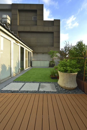 Warm and bright home environment, artificial turf and plank with the use of space. Artificial Turf Beautiful Home Life Modern Natural Architecture Board Building Exterior Built Structure Comfortable Day Fresh Garden Design Grass Growth Landscape Nature No People Outdoors Sky Space Style Texture Tree