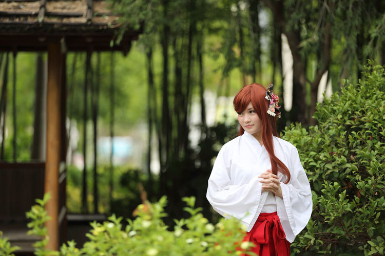 Woman in traditional clothes standing outdoors