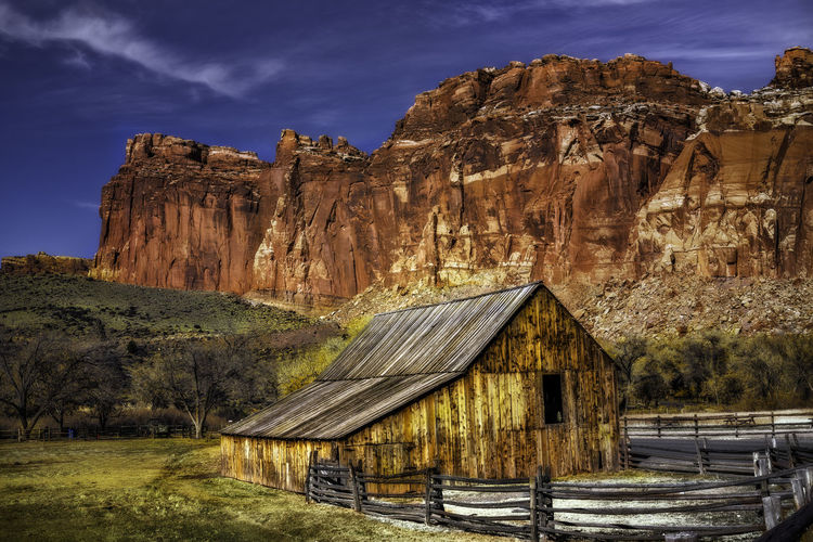 Capitol Reef National Park is a hidden wonder of beauty few people travel to visit. No People Capitol Reef National Park National Parks Adventure Travel Travel Photography Nature Nature Photography Outdoors Outdoor Photography Landscape Landscape Photography Rocks Clouds Colors Desert Sky Scenic View Scenery Trees Landmark Fruita Barn Architecture Rock Formation Travel Destinations