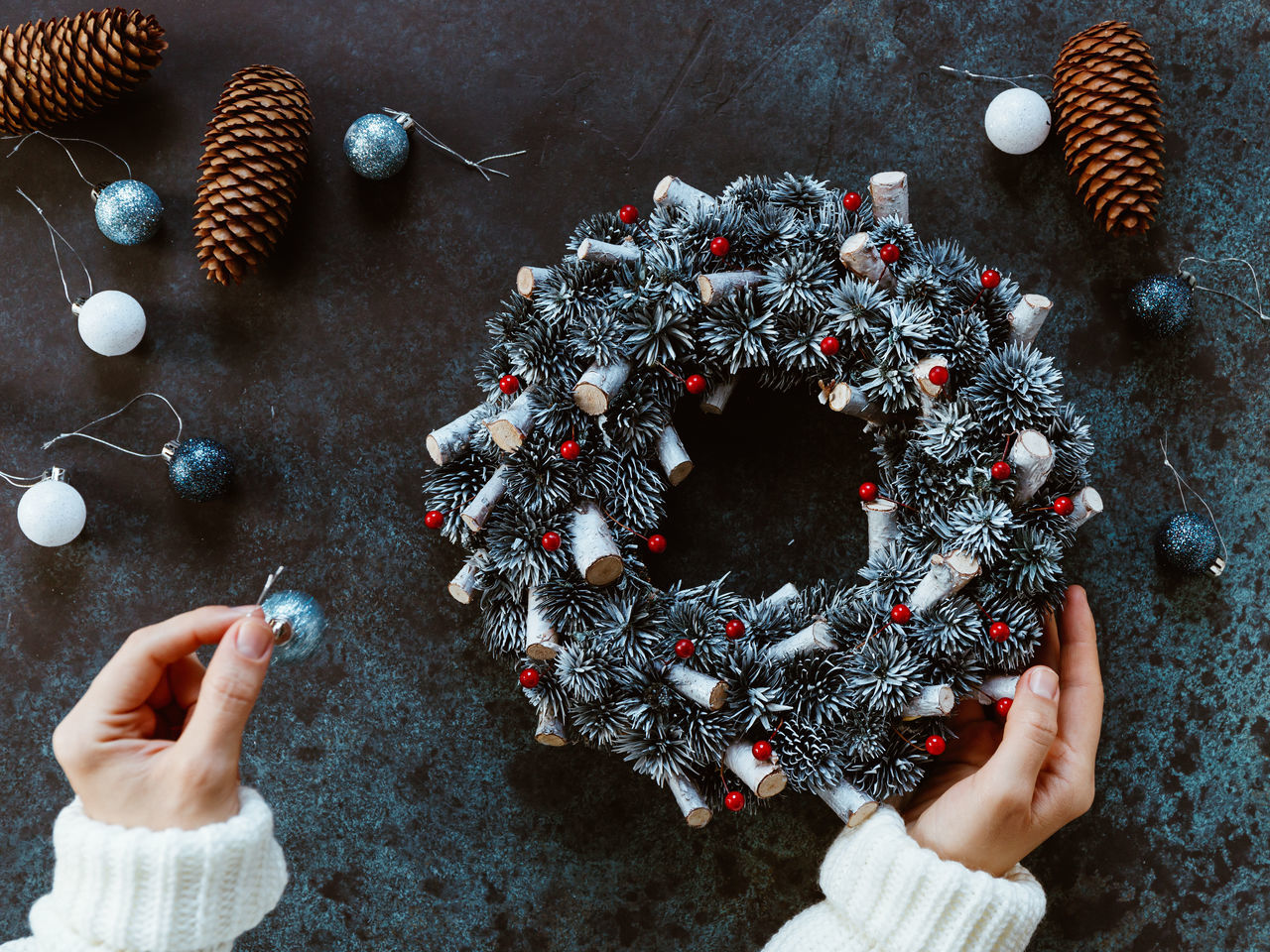Cropped hands of woman holding christmas decoration