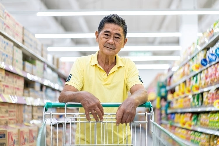 Portrait of smiling man standing in store