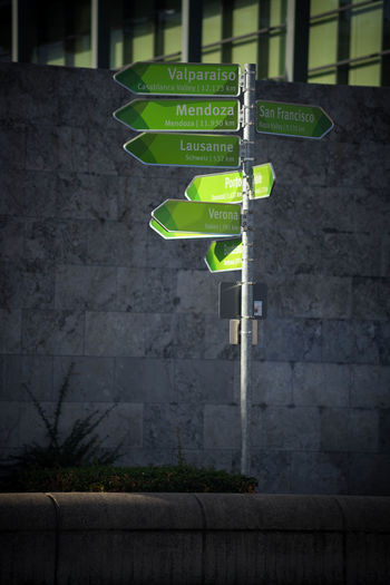 Communication Western Script Text Sign Information Guidance Green Color No People Information Sign Directional Sign Arrow Symbol Architecture Day Wall - Building Feature Outdoors Non-western Script Road Script Street Capital Letter Great Wine Capitals Mainz