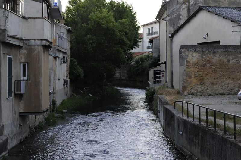 The river Meyne flowing through the town of Orange City France Orange Built Structure Flowing Water Meyne River Residential District River Town Water