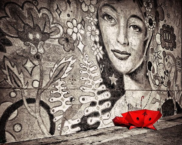 Kip The Wonder Umbrella is a Ladies Man Light And Shadow Red Umbrella Streetphotography Sreetphotography Street Photography Street Art Street Art/Graffiti