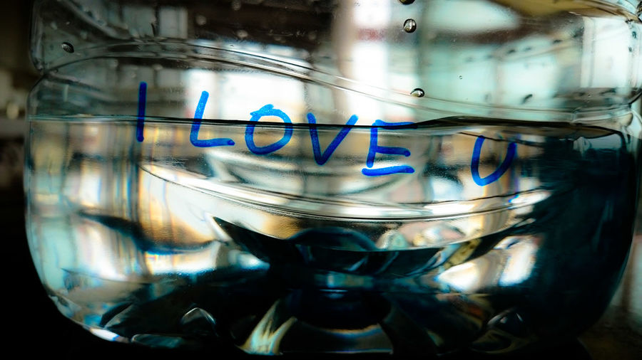 Close-Up Of I Love You Text On Water Bottle