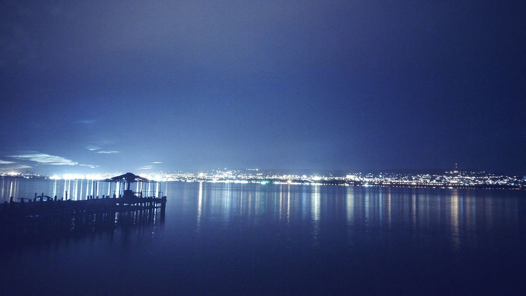 Night Sea Reflection Water Sky Outdoors Tranquility Nature Beauty In Nature Beach No People Sea_collection City Lights City View  Cityscape Night Photography Nightphotography Nightshot Sky Is The Limit ! Night Lights Freshness Sea And Sky Horizon Over Water EyeEm Best Shots Seascape