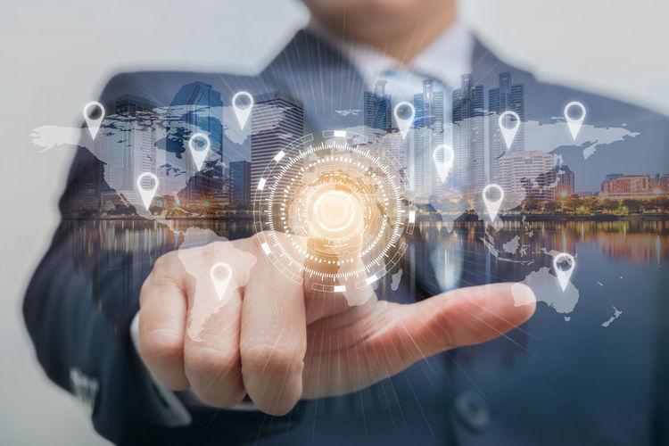 Digital Composite Image Of Businessman Against City