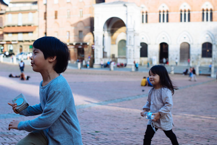 Asian  Bro Casual Clothing Childhood Children Elementary Age Happiness Innocence Kids Leisure Activity Piano Piazza Del Campo Places Playing Real People Siena Sister Tourism Tourist Up Close Street Photography