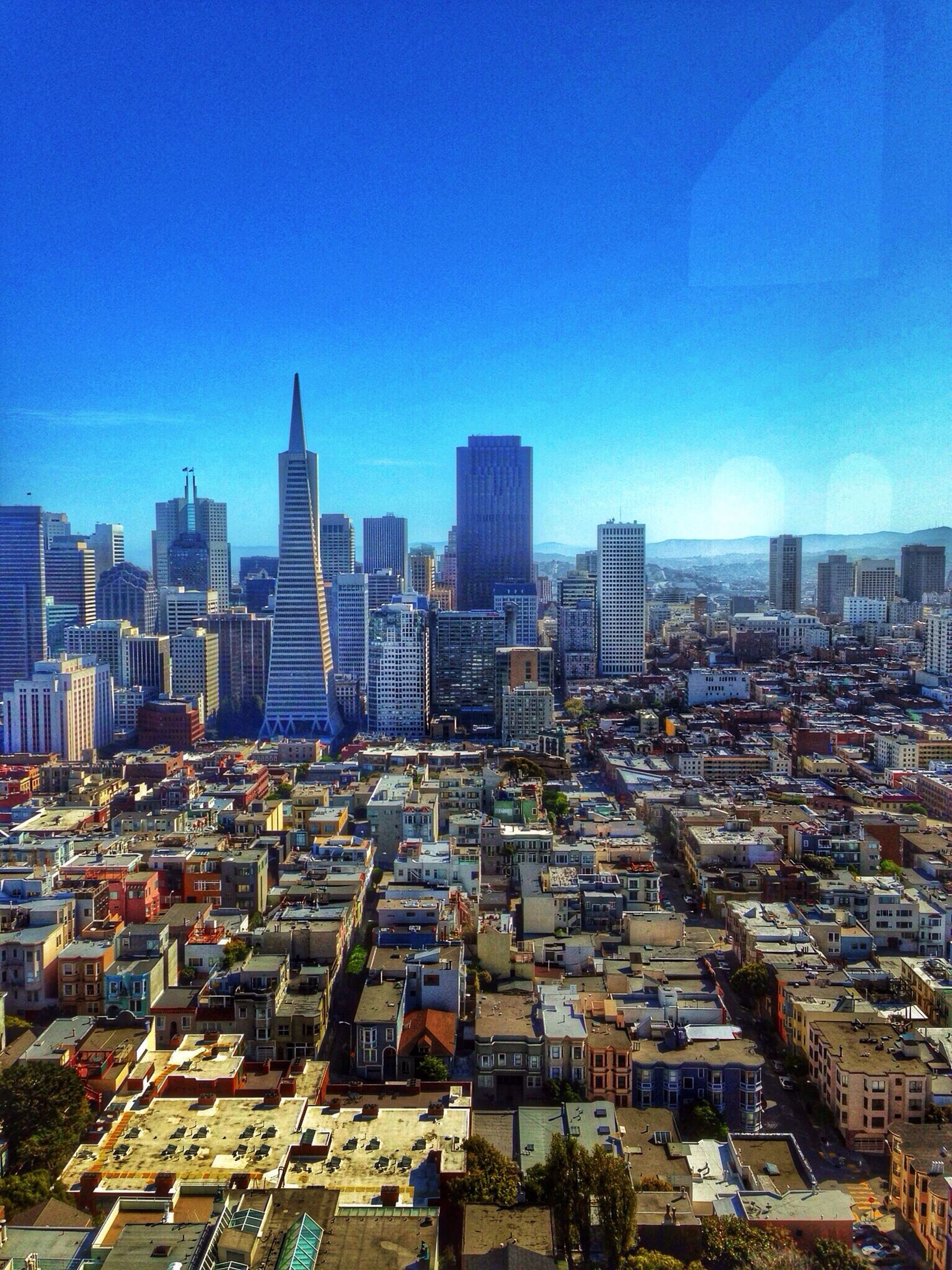 building exterior, city, cityscape, architecture, built structure, skyscraper, clear sky, blue, tower, crowded, tall - high, office building, urban skyline, copy space, modern, high angle view, capital cities, city life, financial district, residential district