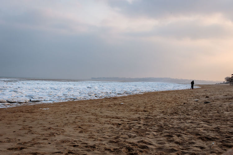 Frozen Hebei Ice Seashore Winter Beach Beauty In Nature Beidaihe China Day Horizon Over Water Nature One Person Outdoors Qinhuangdao Sand Scenics Sea Seascape Seaside Sky Snow Tranquility Vacations Water
