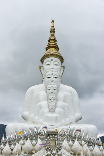 Statue of temple against building