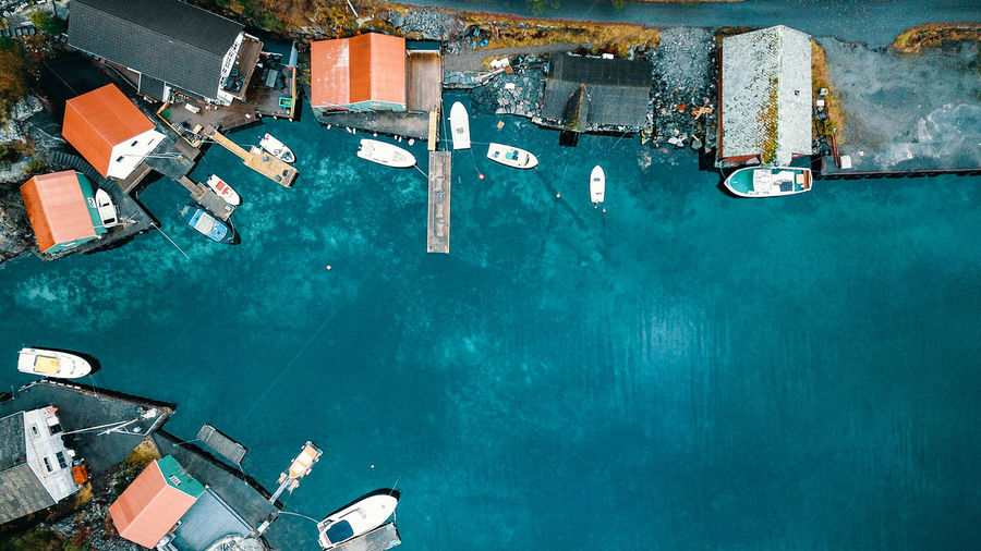 Aerial View Of Houses By Boats Moored Sea In Town