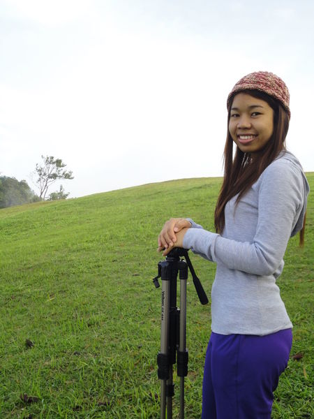 Carry Tripod Photo Day Grass Leisure Activity Lifestyles Nature One Person Outdoors Portrait Real People Sky Standing Tripod Photography Young Adult Young Women