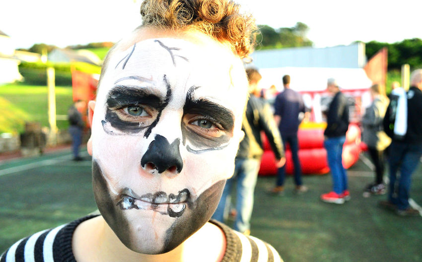 Close-Up Portrait Of Man With Day Of The Dead Face Paint
