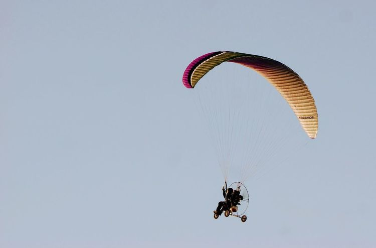 Adult Adventure Day Exhilaration Extreme Sports Flying Jumping Men Mid-air Nature One Person Outdoors Parachute Paragliding People Real People RISK Sky Stunt Person