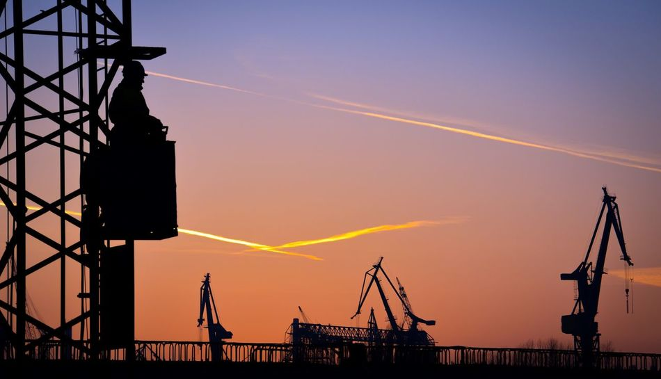 Feierabend Harmony Sunset Silhouette Industry Sky Machinery Outdoors No People Low Angle View Cranes And Construction Cranes Builder Beautiful Sunset End Of Shift Feierabend Harmony Nature's Beautiful Canvas Vapor Trail Industrial Equipment Nature Day Breathing Space Stories From The City