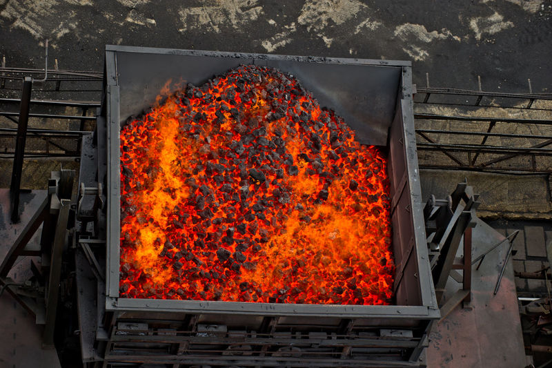 High Angle View Of Burning Charcoal In Coal Mine