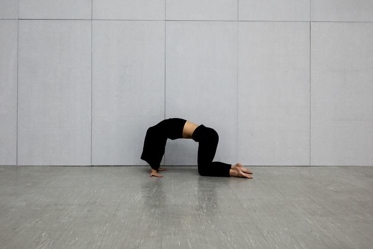Full length of senior man kneeling on floor